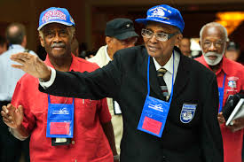 u s department of defense photo essay tuskegee airmen william samber sr and james cooper wave in appreciation at the tuskegee airmen s