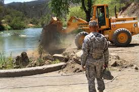 u s department of defense photo essay california army national guard capt jesse bulaong foreground watches as dirt is dumped