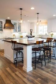 dazzling two glass bottle shaped pendant lights over kitchen island in modern kitchen features white subway area amazing kitchen lighting