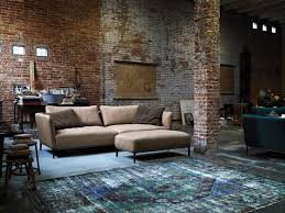 comfortable rolf benz sofa in black and brown rustic living room design exposed brick wall brick living room furniture