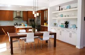 modern kitchen in wood with built in white shelving adjacent to the eat in spacious eat kitchen