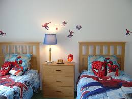 appealing spiderman wall decal to beautify contemporary kids bedroom decorated with twin size bedroom furniture sets which is separated by wooden cabinet charming boys bedroom furniture spiderman