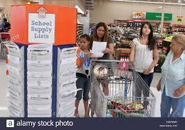 walmart wal mart shopping cart stock photos walmart wal mart multi generation hispanic family members review school supply list and shop at wal mart