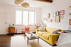 1000 images about yellow sofa on pinterest yellow sofa tan walls and brown curtains bright yellow sofa living