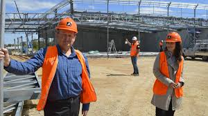 jarvis move creates jobs barossa light herald building project manager david mcnaughton left and jarvis cars marketing manager tania hall