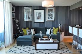 bachelor pad makeover trendy living room photo in miami with gray walls and light hardwood floors blue couches living rooms minimalist