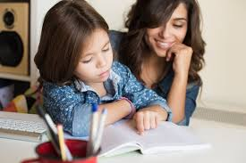 Mother helping her little child with homework The Critical Thinking Child