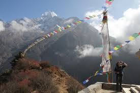 trekking to s everest base camp and kala patthar out hank adjusts a contourhd head mounted camera above namche bazaar