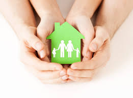 moving to a new city tips for finding a family friendly community hands holding green house family if you re moving to a new city children