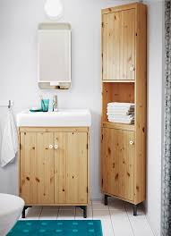 washstand bathroom pine: a small bathroom with a sink cabinet and a corner cabinet in light brown stained solid