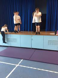 primary four gymnastics they were working independently performing jumps from a height and working a partner to create impressive balances