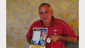 truckie tribute touches naracoorte herald brett brewer shows of the commemorative poster and medal received on behalf of his late father