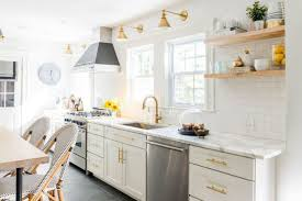 subway kitchen white kitchen with subway tiles and stainless steel appliances