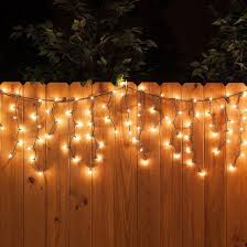 white icicle string lights along the fence a perfect backyard party decoration backyard party lighting