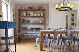 steel dining table room farmhouse metal dining chairs dining room eclectic with beige walls canisters ch