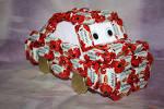 Подарок из игрушек и конфет своими руками