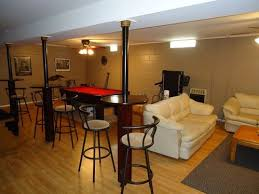 using them to best advantage is certainly the goal great idea on turning those basement support poles into mini tables for a basement rec room basement rec room decorating