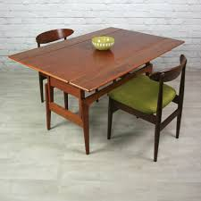 Teak Dining Room Chairs Brown Stained Teak Wood Expandable Dining Table With Drop Leaf And