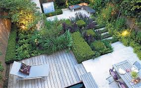a modern garden with decking and smart recliner furniture in style