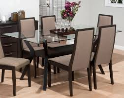 latest dining tables: latest modern dining room design with glass dining table top feat cream high back dining chairs