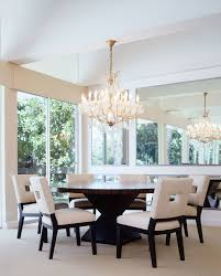 miscellaneous trendy dining room photo in los angeles with white walls breakfast table lighting