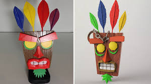 Two different 3D prints of the Crash Bandicoot <b>Aku Aku mask</b>