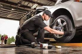tires auto repair automotive services woodstock ontario technician fixing tire downey