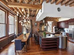wood slab dining table beautiful: view in gallery  beautiful glass pendants over long dining table