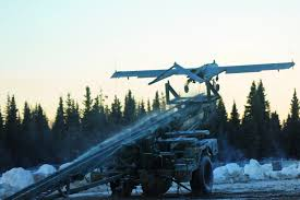 u s department of defense photo essay an rq7 shadow unmanned aircraft system flies off its launcher on forward operating base sparta on