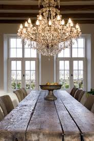 rough farmhouse table, <b>crystal chandelier</b>. Not this exact thing but ...