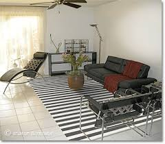 rugs living room nice: white arizona living room with black furniture and a black and white striped area