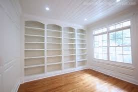 library built ins wainscoting wall to wall book shelving with custom bookshelves that dont have to break the bank learn how to build your own with built home library