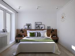 view in gallery wooden headboard and bedside tables along with sconce lighting made for book lovers bedside sconce lighting