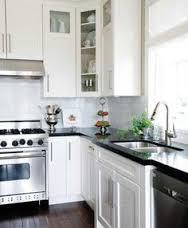 white kitchen enlivened smattering kitchen dark floors white cabinets dark counters