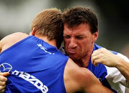 Brent Harvey of the Kangaroos wrestles with team-mate Andrew Swallow during a Kangaroos AFL training session at the Arden Street Oval on December 12, ... - Kangaroos%2BTraining%2BSession%2BgyF0leRkDvtl