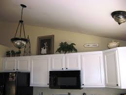 above kitchen cabinets ideas red above kitchen cabinet lighting