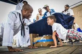 u s department of > photos > photo gallery navy petty officer 2nd class paul donaldson executes a pushup a child during a navy