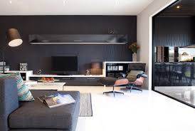 living room example of a trendy living room design in melbourne with black walls and a cabinet gtgt