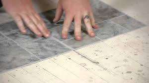 Laying Kitchen Floor Tiles How To Lay Vinyl Tiles On Top Of Old Flooring Flooring Help