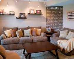marvelous basement track lighting combined with black shelves over light brown couch basement track lighting