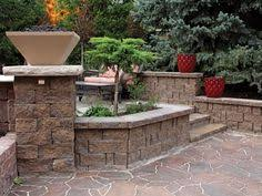 gallery outdoor living wall featuring: courtyard featuring highland stonear wall system and manufactured fire feature