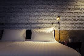 when we say this is an original lighting idea we mean it this bedside sconce lighting is created from shop light fixtures wire and electrical conduit bedside lighting ideas