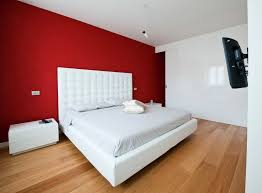 red wall paint black bed: the modern home decor bedroom with red wall paint