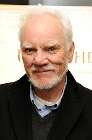 "Malcolm McDowell. ""I'm in the middle of making a cup of coffee,"" Malcolm said to begin our conversation. His voice, still thick with an English accent after ... - Malcolm_McDowell"
