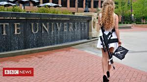 Kaitlin Bennett: Why she wore a rifle for graduation photos - BBC News