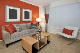 greige sofa against orange wall buy living room