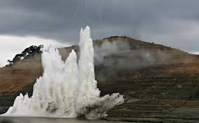 gallery years of the canal in photos newshour a controlled explosion sends water into the air in the canal during a sept