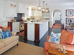 art deco home and orange fabric sofa also cream fur rug plus white kitchen island plus single kitchen sink under three pendant lamps art deco kitchen lighting