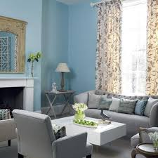 gray sofa with clean lines white furniture and light blue walls would probably blue and white furniture