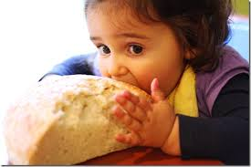 Image result for pictures of people eating bread